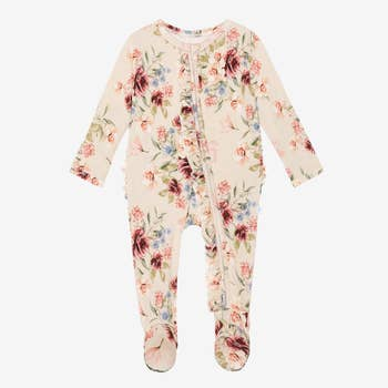 Front of peach colored bamboo footie pajamas, garden floral print all over