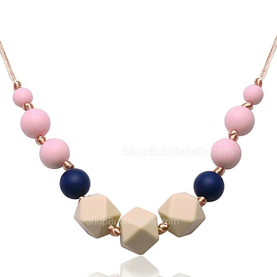 Geometric silicone teething jewelry, pink tan, navy chew beads