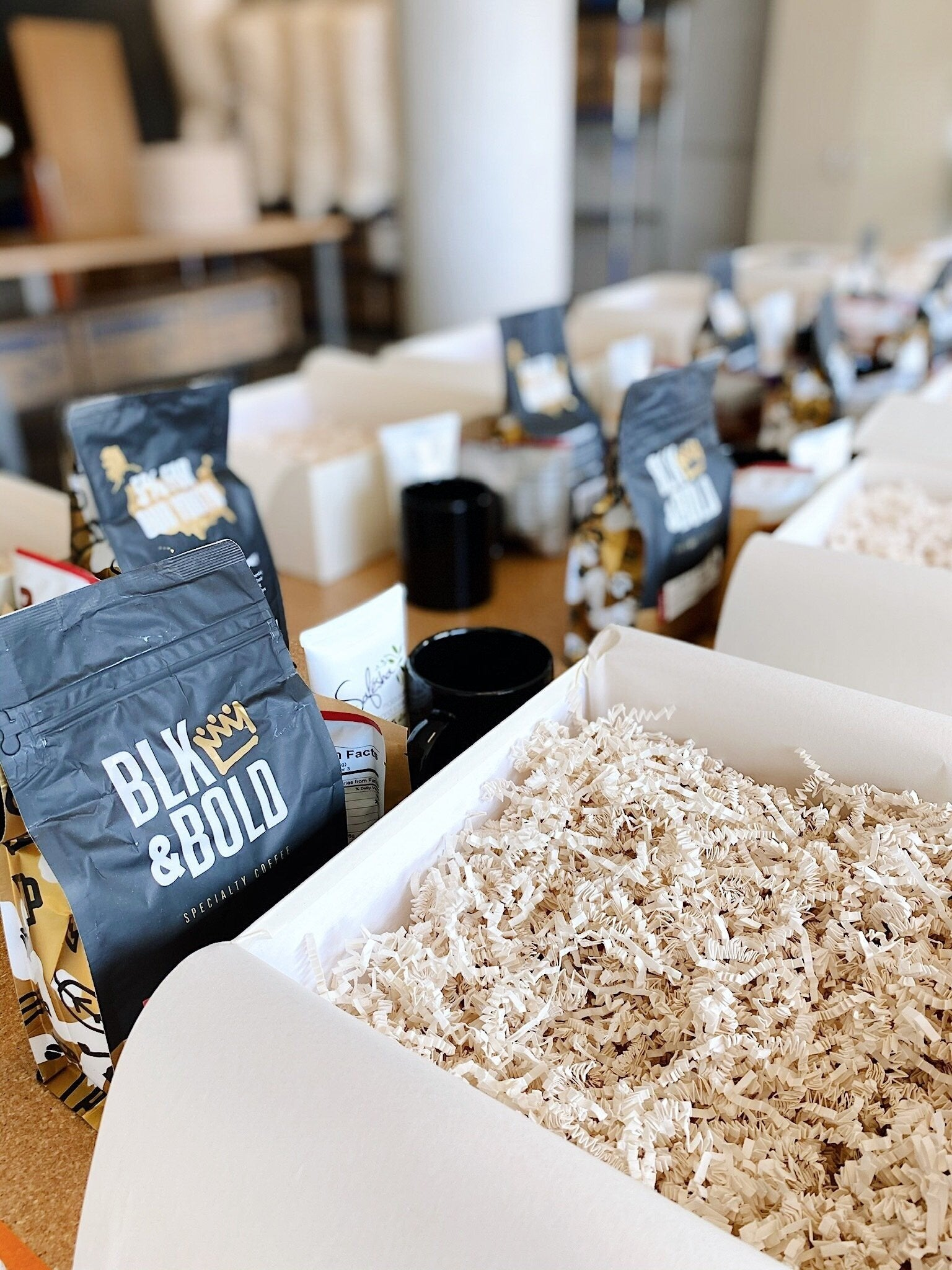 BLK & Bold coffee beans being packed into a Minny & Paul corporate gift order
