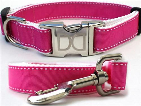 Pink ribbon collar with white accent stitching and aluminum buckle