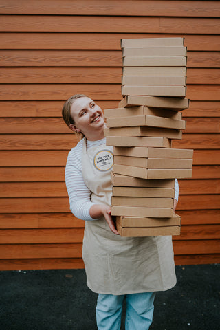 Girl with large pile of baking kits
