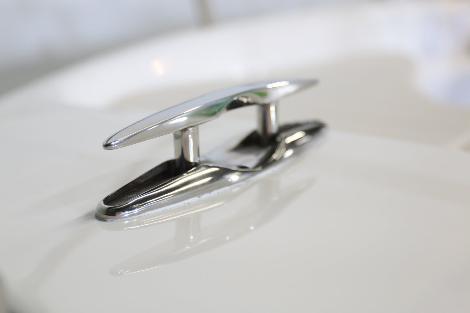Image of a stainless steel retractable boat cleat for sale online at Sardine Marine