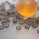 Tibetan daisy spacer 4mm antique copper Tiny bead bali style