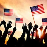 silhouettes of people waving and holding American flags