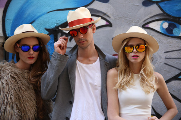 three models wearing sunglasses