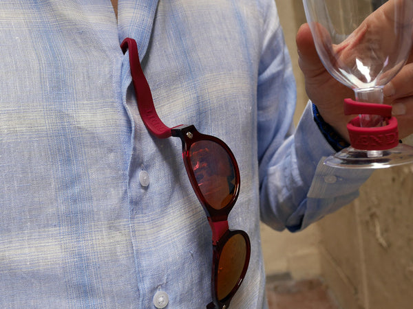 pair of red beandit sunglasses hanging from a shirt