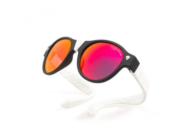 black frames with red lenses and white arms