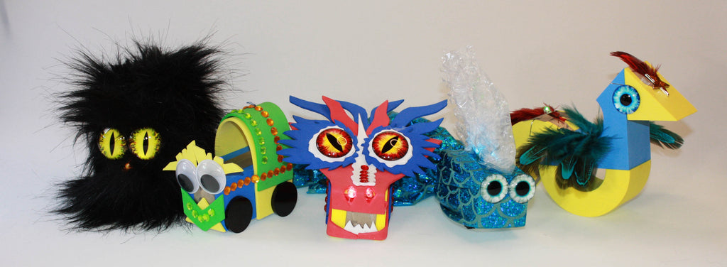 5 TapeBlock Characters in a horozontal row: Black fur character, Green and Blue Train, Dragon, Fish and Bird