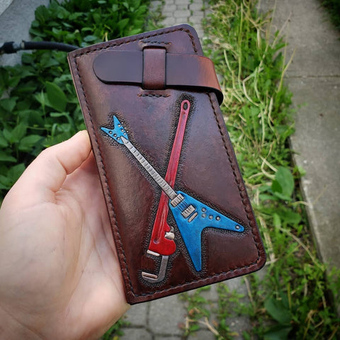 handmade phone wallet with guitar and pipe wrench hand tooled and painted