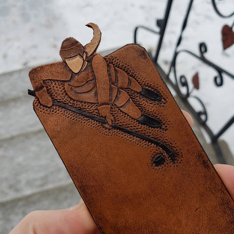 Hand-tooled brown leather female hockey player bookmark