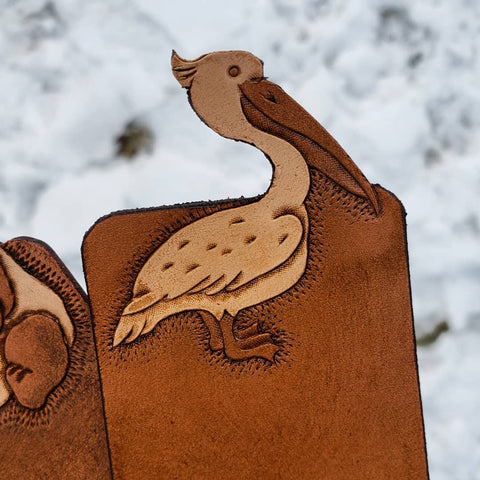 Hand-tooled brown leather pelican bookmark