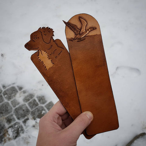 Hand-tooled brown leather tolling retriever and loon bird bookmarks