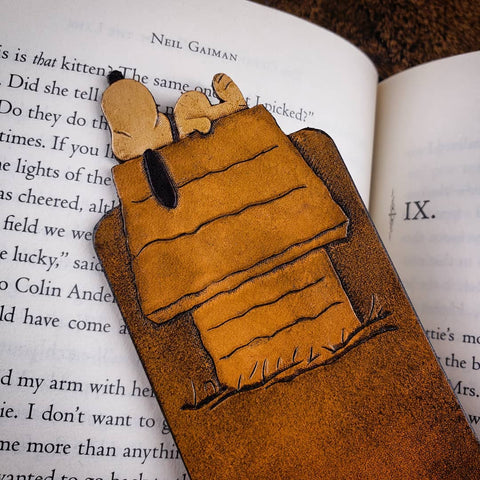 Hand-tooled brown leather Snoopy bookmark