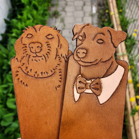 Hand-tooled brown leather dog bookmark.
