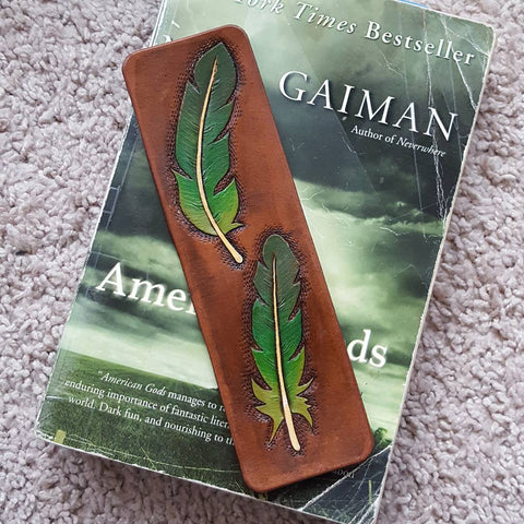 Hand-tooled brown leather green feathers bookmark