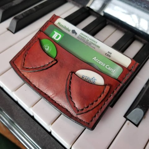 brown minimalist card wallet with two card slots and two pick pockets for guitar picks.