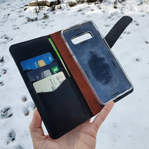 handmade phone wallet with blue heron hand tooled and painted
