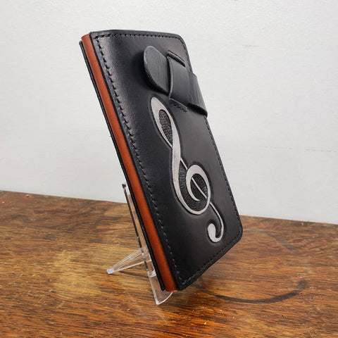handmade phone wallet with music treble clef hand tooled and painted
