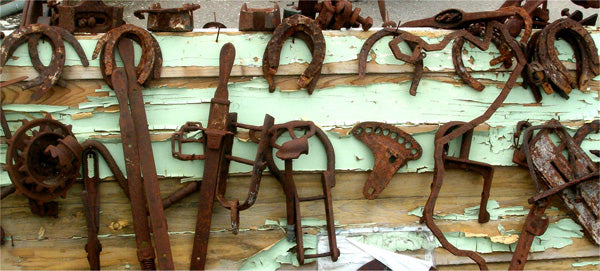 Rusty tools and horse shoes