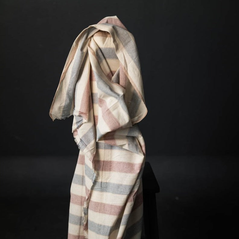 Dawn Break Woven Cotton by Merchant and Mills.  Red, blue and nude stripes on a warm creamy white background.  This cloth is suitable for tops, pyjamas or skirts and dresses with fullness.   Stitch Piece Loop, Australia