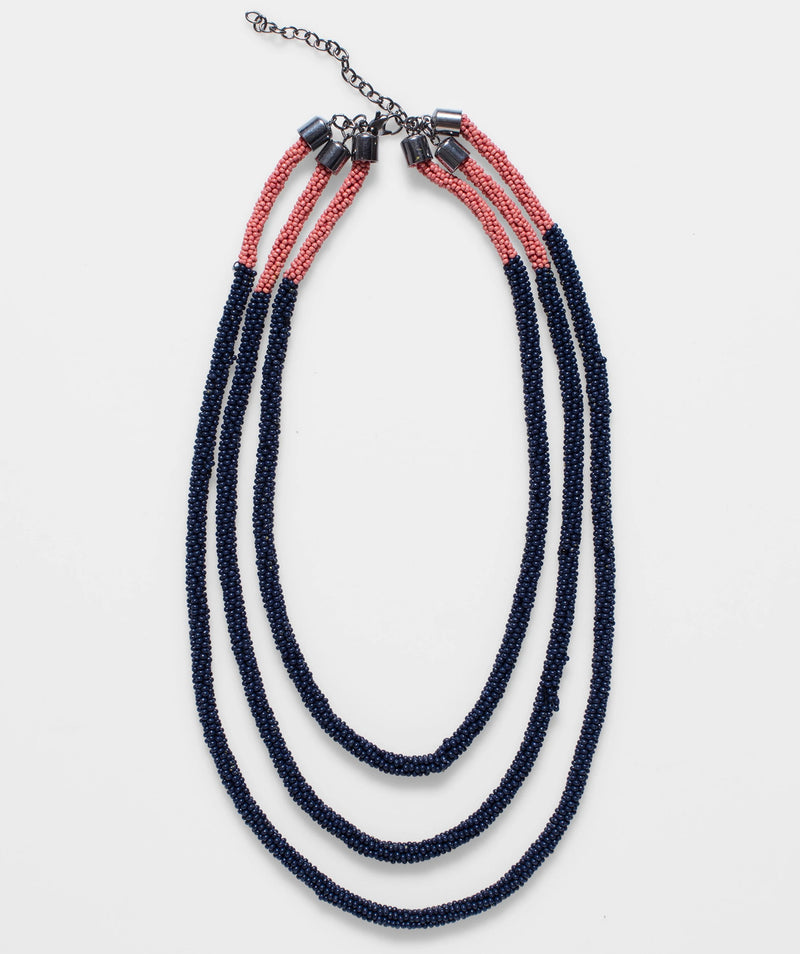 Ettie Necklace by Elk the Label | Stitch Piece Loop | Noosa Heads | The Ettie Necklace in Navy & Rococco by Elk The Label is a gorgeous three strand beaded necklace in a modern colour block pattern |