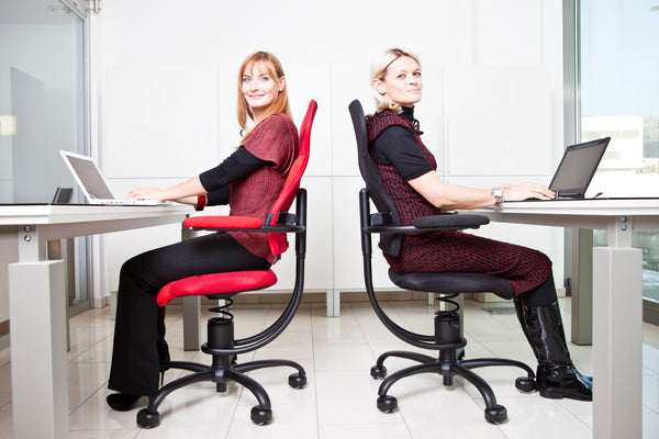 ergonomic office chairs Vancouver two ladies sitting back to back - Spinalis Chairs Canada