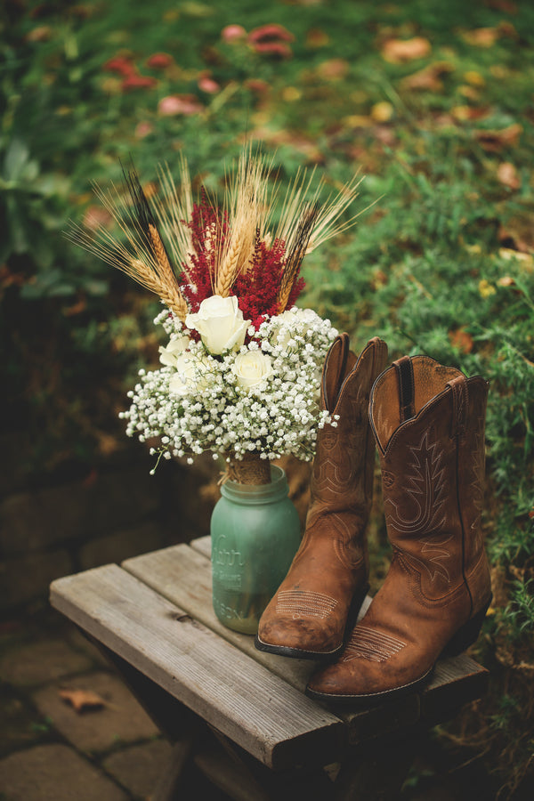 Classic western country style wedding floral decoration and cowboy boots