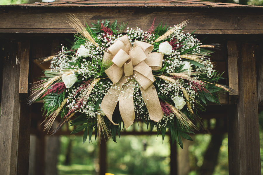 Under Rustic floral ball to tie the knot