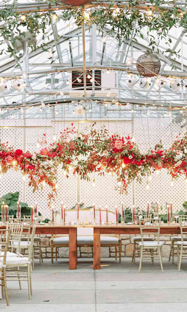 Floral, foliage and crystal chandeliers Amazing Tented Wedding Decoration Ideas To Wow Your Guests