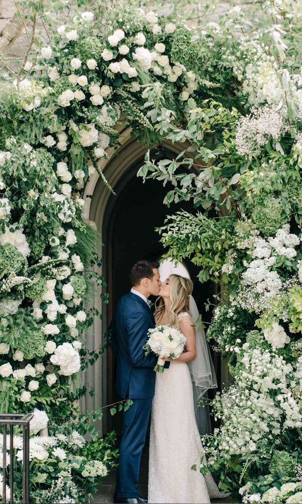 Charming floral entrance for tented wedding reception ideas