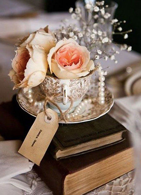 DIY a antique look vintage wedding centerpieces with old books, frames and old tea pots
