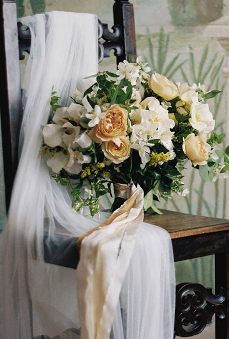 Over-sized-yellow-wildflower-wedding-bouquets-with-Luxe-ribbons