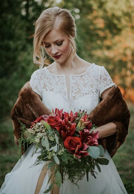 Pair your wedding dress with a mink shawl in case to catch cold