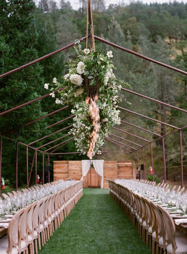 hang string lights and greenery on Montana outdoor ranch wedding reception