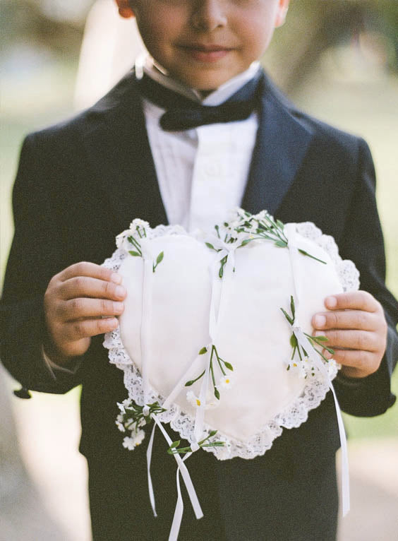 Ring Bearer holds a DIY Hearts Wedding Ring Pillow for Your Wedding