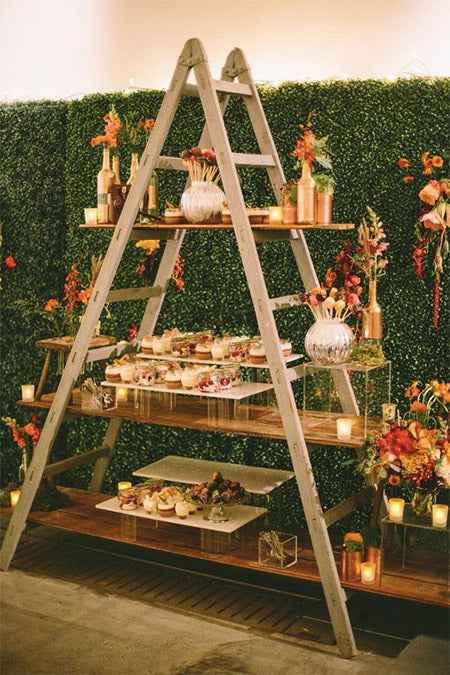 Turn a seemly useless old ladder into a gorgeous wedding decor