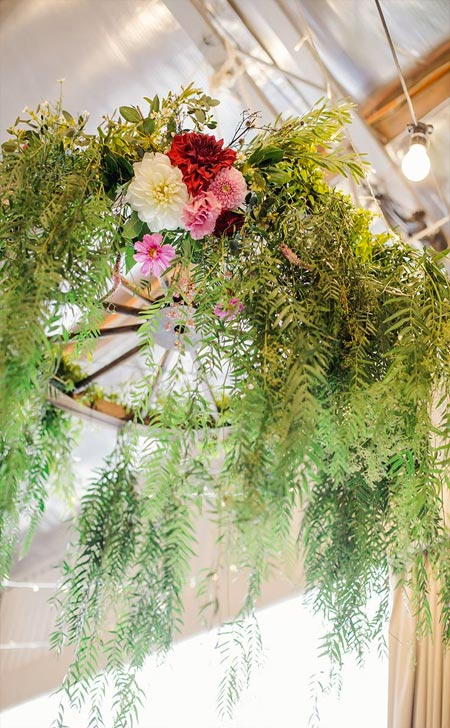 DIY a personalized chandelier either deluxe or rustic simple with recycled wagon wheel, mason jars, candles, crystals, greenery and flowers.