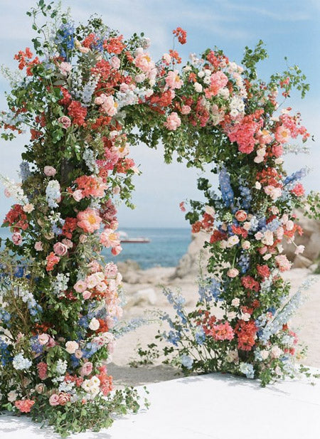 cherry-red-and-blue-Bold-and-natural-wedding-lush-floral-arches