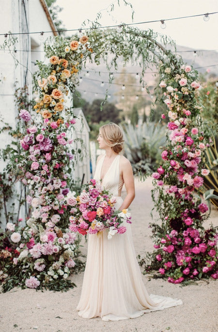 pink-yarrow-and-rust-orange-Bold-and-natural-wedding-lush-floral-arches