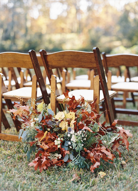 fall wedding chair decoration with maple leaves