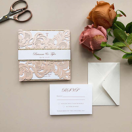 https://clearweddinginvites.com/collections/blush-pink-wedding-invites/products/inviting-blush-shimmer-laser-cut-pocket-with-classic-invitation-and-glittery-backer-cwil27