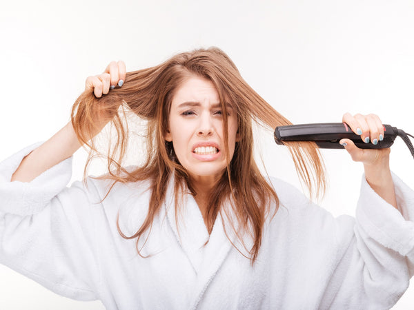 hot iron on wet hair