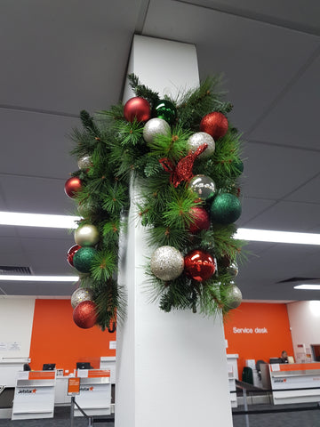 office christmas decorations on office pillar