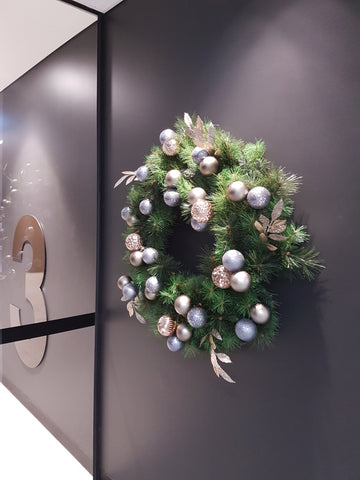 Christmas wreath corporate office wall