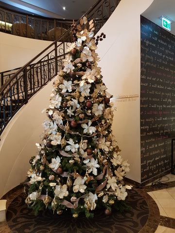 christmas tree by star case in foyer