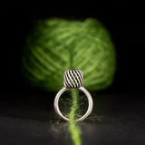 Sterling Silver Yarn Cake Ring With Knitting Needle Motif