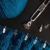 Gifts for Knitters -Essential Tools-Silver Stitch Markers on a knitting project
