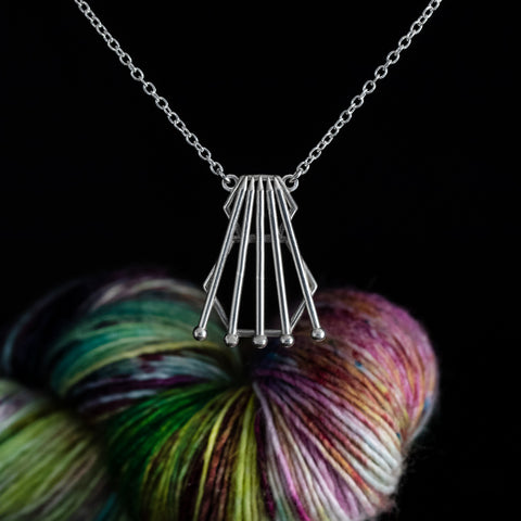 4 Knitting Needles & A Spare Necklace
