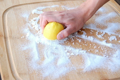 Cleaning Cutting Board with Lemon