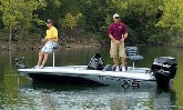 two guys on a boat fishing